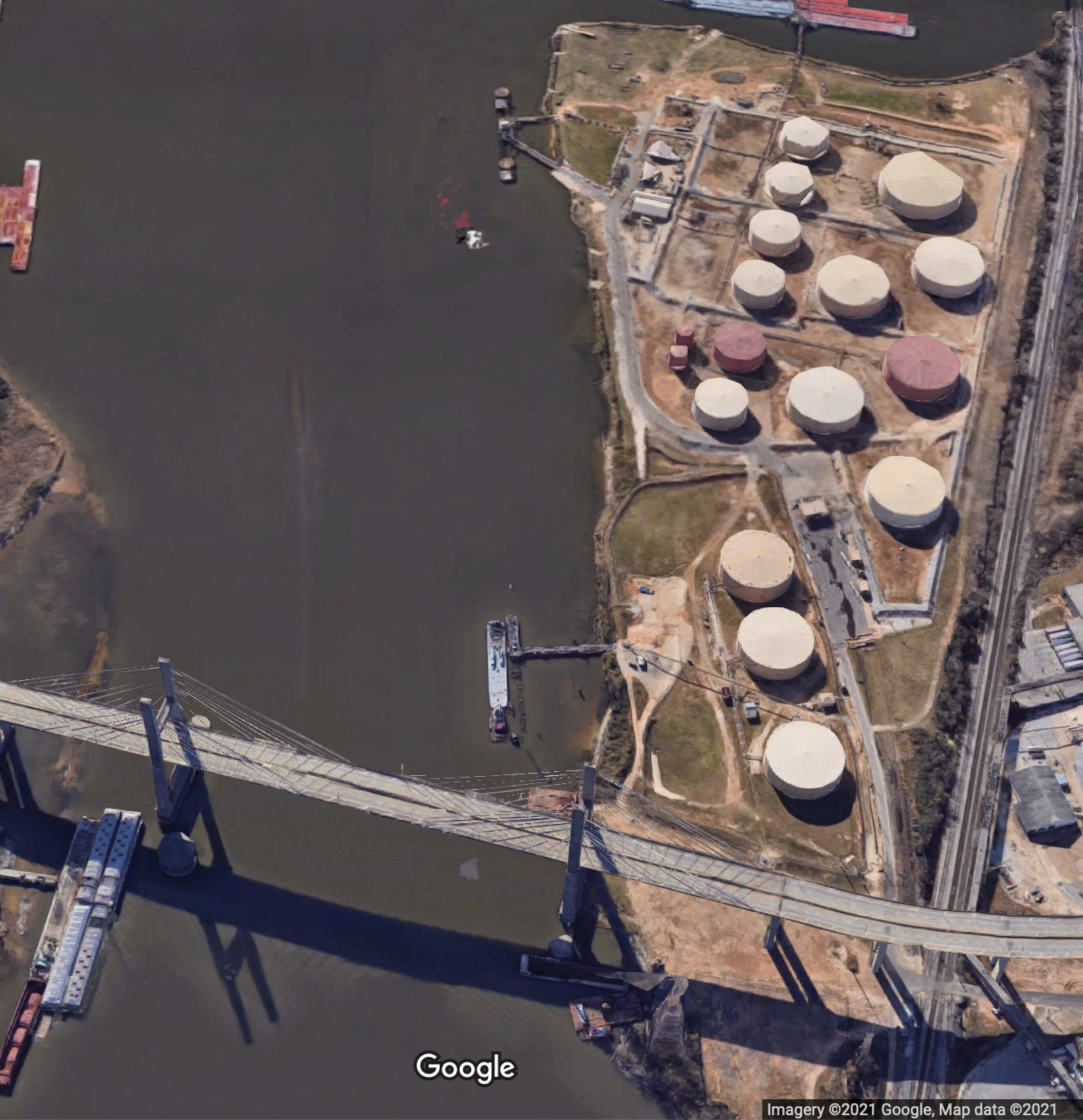 A satellite image of the above ground oil storage tank farm at Magazine Point in Africatown with the Africatown Bridge in the foreground.